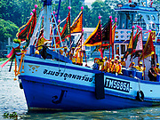 """02 JUNE 2017 - SAMUT SAKHON, THAILAND: Boats carrying the devotees of the City Pillar Shrine sail on the Tha Chin River in Samut Sakhon during the procession for the shrine. The Chaopho Lak Mueang Procession (City Pillar Shrine Procession) is a religious festival that takes place in June in front of city hall in Samut Sakhon. The """"Chaopho Lak Mueang"""" is  placed on a fishing boat and taken across the Tha Chin River from Talat Maha Chai to Tha Chalom in the area of Wat Suwannaram and then paraded through the community before returning to the temple in Samut Sakhon. Samut Sakhon is always known by its historic name of Mahachai.      PHOTO BY JACK KURTZ"""