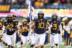 Sep 8, 2018; Morgantown, WV, USA; West Virginia Mountaineers linebacker Dylan Tonkery (10) carries the West Virginia state flag onto the field before their game against the Youngstown State Penguins at Mountaineer Field at Milan Puskar Stadium. Mandatory Credit: Ben Queen-USA TODAY Sports