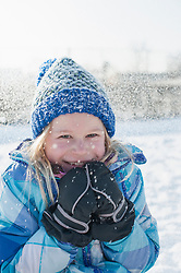 Portrait of girl shivering in winter