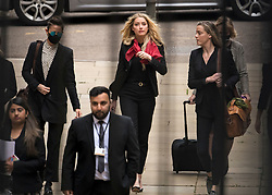 © Licensed to London News Pictures. 16/07/2020. London, UK. American actress AMBER HEARD (centre) arrives at the High Court in London where Johnny Depp is in a legal dispute with UK tabloid newspaper The Sun over allegations he assaulted his former wife, Amber Heard. Photo credit: Ben Cawthra/LNP