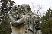 Kerepesi Cemetery (Fiumei uti nemzeti sirkert), Budapest, Hungary. Grieving naked woman