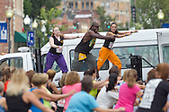 Middletown, New York - Instructors Studio Ayo lead the crowd during Zumba in the Street at the Run 4 Downtown road race on Aug. 18, 2012.