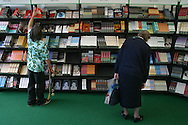 Visitors to the Edinburgh International Book Festival browse for books from titles by the almost 550 writers who took part in this year's record-breaking Edinburgh International Book Festival, which ends today, and which reported the greatest visitor numbers in the event's 21-year history. The book festival was a part of the Edinburgh International Festival, the largest annual arts festival in the world.