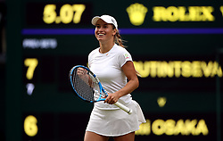 Yulia Putintseva celebrates after beating Naomi Osaka on day one of the Wimbledon Championships at the All England Lawn Tennis and Croquet Club, Wimbledon.