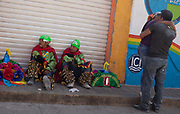 Carnival performers resting after their show. The annual Carnival in Zoque Coiteco, a district of Chiapas in Southern Mexico happens in the five days preceeding Ash Wednesday along with Carnival throughout the Americas. Participants dress in colourful costumes with masks depicting famous political and entertainment figures, and throw talcum powder at each other.