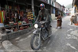 Round the World Doug Wothke passing through Modibeni on Day-7 of our Himalayan Heroes adventure riding from Tatopani to Pokhara, Nepal. Monday, November 12, 2018. Photography ©2018 Michael Lichter.