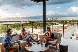 Outdoor patio and downtownview at  Atico, Fort Worth, Texas, USA. Atico is a Spanish tapas bar atop a Stockyards hotel and is owned by Tim Love.