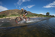 Theo Blignaut and Cherise Stander of Team RECM mixed cross the Breede river during stage 2 of the 2014 Absa Cape Epic Mountain Bike stage race from Arabella Wines in Robertson, South Africa on the 25 March 2014<br /> <br /> Photo by Greg Beadle/Cape Epic/SPORTZPICS