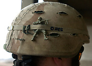 Sgt. Ron Clement, 24, of Corvallis, wears a plastic army figure in the band his helmet during a patrol Saturday, Jan. 22, 2005. Clement is with Bravo Company, 1st Platoon, based at Camp Taji, north of Baghdad. Bravo Company is part of the 2nd Battalion, 162nd Infantry of the Oregon Army National Guard. Photo by Randy L. Rasmussen