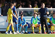 Oxford United manager Karl Robinson with hands open appearing to ask a question during the EFL Sky Bet League 1 match between AFC Wimbledon and Oxford United at the Cherry Red Records Stadium, Kingston, England on 29 September 2018.