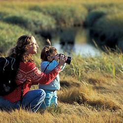 Biddeford, ME. A mother and daughter explore a salt marsh near Biddeford Pool.  TPL project - Anuszewski property.