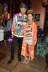 LLOYD NWAGBOSO and ANA TANAKA at a party to celebrate the launch of fashion retailer WeKoko.com held at Sketch, 9 Conduit Street, London on 13th April 2016.