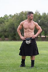 sexy shirtless man in a kilt