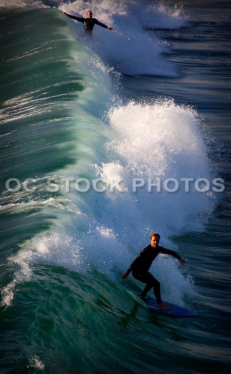 Surfing Waves In Huntington Beach