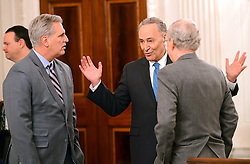United States Senate Minority Leader Chuck Schumer (Democrat of New York), center, engages in conversation with US House Majority Leader Kevin McCarthy (Republican of California), left, and US Senate Majority Leader Mitch McConnell (Republican of Kentucky), right, prior to the arrival of President Donald Trump at a reception for US House and US Senate Republican and Democratic leaders in the State Dining Room of the White House in Washington, DC, USA, on Monday, January 23, 2017. Photo by Ron Sachs/CNP/ABACAPRESS.COM