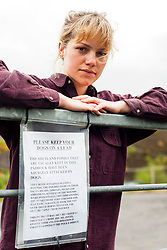 Jennifer Gleadhall with the Sign on the gate at Moss Road, Totley where her two Shetland Ponys were attacked by dogs<br /> 21 May 2013<br /> Image © Paul David Drabble<br /> www.pauldaviddrabble.co.uk