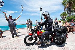 Joe Gimpel riding his 640cc 1940 Indian over the finish line of the Cross Country Chase motorcycle endurance run from Sault Sainte Marie, MI to Key West, FL. (for vintage bikes from 1930-1948). The Grand Finish in Key West's Mallory Square after the 110 mile Stage-10 ride from Miami to Key West, FL and after covering 2,368 miles of the Cross Country Chase. Sunday, September 15, 2019. Photography ©2019 Michael Lichter.