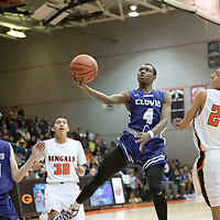 Dewayne Dawson (4) of Clovis scores on the drive to the basket with Gallup defenders watching at the Gallup Invitational held at Gallup High School. Clovis won 64-53.