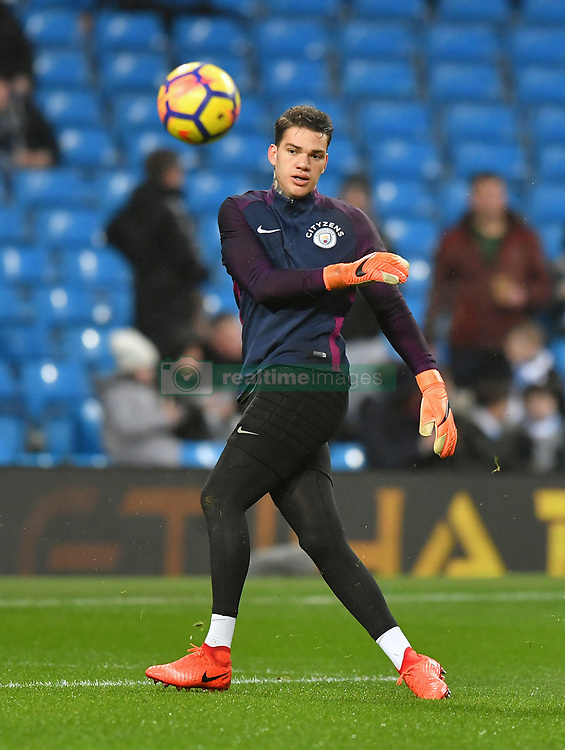 Manchester City goalkeeper Ederson warms up before the game