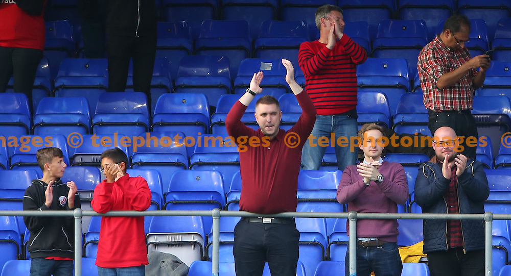 Crawley fans applaud the team after  the Sky Bet League 2 match between Hartlepool United and Crawley Town at Victoria Park in Hartlepool. October 8, 2016.<br /> James Boardman / Telephoto Images<br /> +44 7967 642437