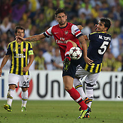 Fenerbahce's Mehmet Topal (R) and Arsenal's Olivier Giroud during the UEFA Champions League Play-Offs First leg soccer match Fenerbahce between Arsenal at Sukru Saracaoglu stadium in Istanbul Turkey on Wednesday 21 August 2013. Photo by TURKPIX