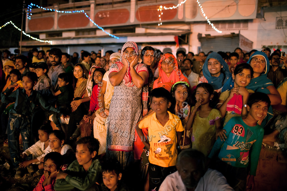 Indians are observing the firework display during celebrations for the Dussehra Festival in Bhopal, Madhya Pradesh, India, site of the 1984 Union Carbide (now DOW Chemical) gas disaster.