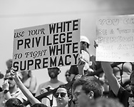 """Sign held at a """"Take Em Down NOLA"""" rally across from Jackson Square in French Quarter in New Orleans following a march held in solidarity with Charlottesville, VA."""