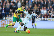 Timm Klose of Norwich city (l) fouls Bafetimbi Gomis of Swansea city. Barclays Premier league match, Swansea city v Norwich city at the Liberty Stadium in Swansea, South Wales  on Saturday 5th March 2016.<br /> pic by  Andrew Orchard, Andrew Orchard sports photography.