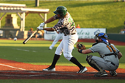24 July 2015:  Designated hitter Aaron Wright bats during a Frontier League Baseball game between the Gateway Grizzlies and the Normal CornBelters at Corn Crib Stadium on the campus of Heartland Community College in Normal Illinois
