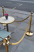 Chairs and a table with flowers are set behind a rope barrier for customers to sit outside a cafe on the street in Piccadilly during the second (Autumn) wave of the Coronavirus pandemic, on 8th October, 2020, in London, England. (Richard Baker / In Pictures via Getty Images)