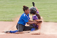 Middletown, New York - A Warwick baserunner slides into second base as the ball gets past the Middletown shortstop during a varsity girls' softball game on May 27, 2014.