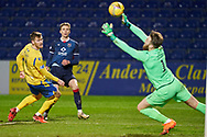Oli Shaw of Ross County strikes but saved by Alexander Clark during the Scottish Premiership match between Ross County FC and St Johnstone FC at the Global Energy Stadium, Dingwall, Scotland on 2 January 2021