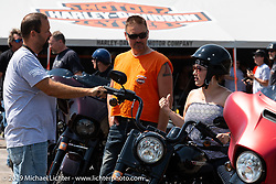 Shawn and Michelle Markman of Worthingtin, MN get help from Harley-Davidson Event Coordinator Steven Wells with Harley-Davidson test rides out of the Sturgis Civic Center on Lazelle during the Sturgis Black Hills Motorcycle Rally. SD, USA. Thursday, August 8, 2019. Photography ©2019 Michael Lichter.