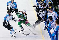 Jamie Fraser (HDD Tilia Olimpija, #44) and Marton Vas (SAPA Fehervar AV19, #42) while referee jumps during ice-hockey match between HDD Tilia Olimpija and SAPA Fehervar AV 19 in 19th Round of EBEL league, on November 4, 2011 at Hala Tivoli, Ljubljana, Slovenia. (Photo By Matic Klansek Velej / Sportida)