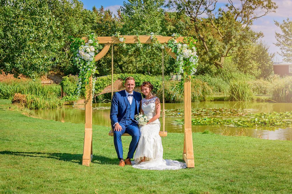 bride and groom on wedding swing