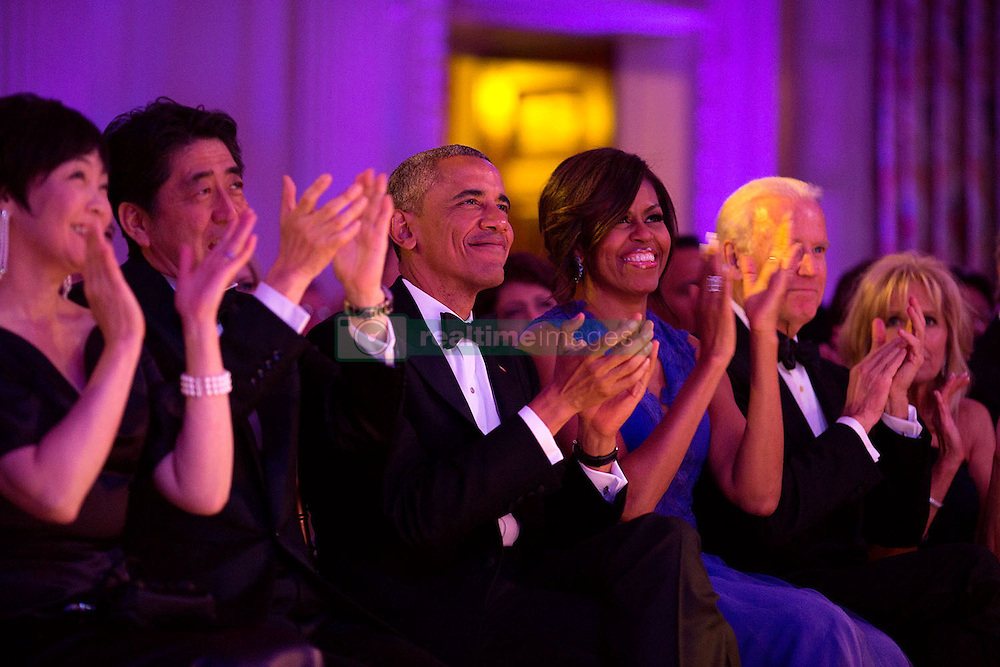 """President Barack Obama and First Lady Michelle Obama, with Prime Minister Shinzo Abe of Japan, First Lady Akie Abe, Vice President Joe Biden and Dr. Jill Biden, applaud the cast of """"Jersey Boys"""" during the State Dinner performance in the State Dining Room of the White House, April 28, 2015. (Official White House Photo by Pete Souza)<br /> <br /> This official White House photograph is being made available only for publication by news organizations and/or for personal use printing by the subject(s) of the photograph. The photograph may not be manipulated in any way and may not be used in commercial or political materials, advertisements, emails, products, promotions that in any way suggests approval or endorsement of the President, the First Family, or the White House."""