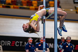 Marijke Esselink in action on high jump during the Dutch Athletics Championships on 14 February 2021 in Apeldoorn