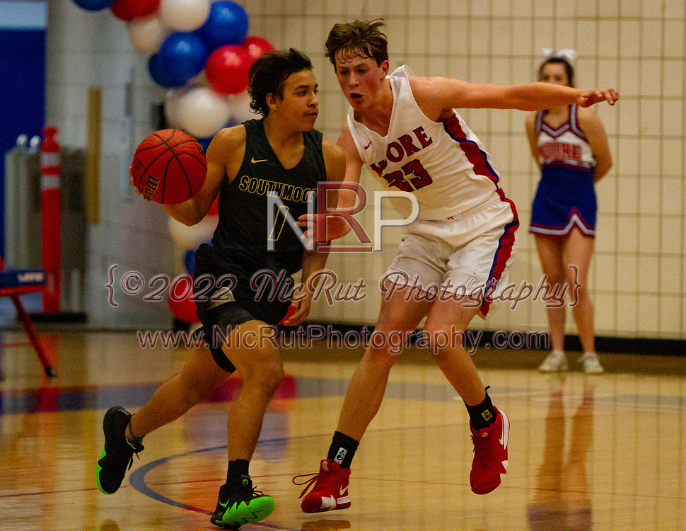 Southmoore's Damian Kline tries to find space to drive the ball to the basket against Moore's Dylan McDougal during their game on Tuesday, December 18, 2018 at Moore High School.