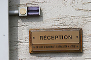 A door bell and sign saying reception, please call next door if no one is here, Champagne Larmandier-Bernier, Vertus, Cote des Blancs, Champagne, Marne, Ardennes, France