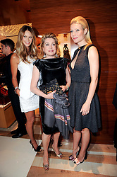 Left to right, Elle Macpherson, Catherine Deneuve and Gwyneth Paltrow at a party to celebrate the opening of the Louis Vuitton Bond Street Maison, New Bond Street, London on 25th May 2010.