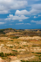 Painted Canyon Panorama. Theodore Roosevelt National Park. Image taken with a Nikon D3 and 85 mm f/2.8 PC-E lens (ISO 200, 85 mm, f/16, 1/40 sec). 9 of 9 images combined with AutoPano Giga and Dehaze Filter.