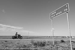 """Motorcycle Cannonball organizer Lonnie Isam Jr riding his 1934 Harley-Davidson VL into Limon, CO as he passes the """"MCR Half way to Tacoma"""" sign during Stage 9 (249 miles) of the Motorcycle Cannonball Cross-Country Endurance Run, which on this day ran from Burlington to Golden, CO., USA. Sunday, September 14, 2014.  Photography ©2014 Michael Lichter."""