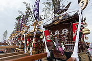 Mikoshi gather on the beach during the Hamaorisai matsuri in Chigasaki, Kanagawa, Japan. Monday July 17th 2017.  This festival is celebrated on Marine Day in Japan. Over 40 mikoshi (portable shrines) are paraded through the night to arrive on the coast at Southern Beach where they are blessed in a Shinto ritual before being carried into the waves to be purified.