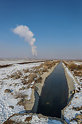 Water flows throughout the canal that appears to be coming from the cooling towers of Metsamor nuclear power station in Armenia on Friday, Jan 22, 2021. It is one of the last old operating Soviet reactors built without containment vessels, its location in a seismic zone has drawn renewed attention since Japan's earthquake-and-tsunami-triggered crisis. Nuclear Engineering International reported on January 18 that Armenia plans to extend the service life of its five-decade-old nuclear power plant in Metsamor after 2026 and has not abandoned plans to build a new plant. (Photo/ Vudi Xhymshiti)