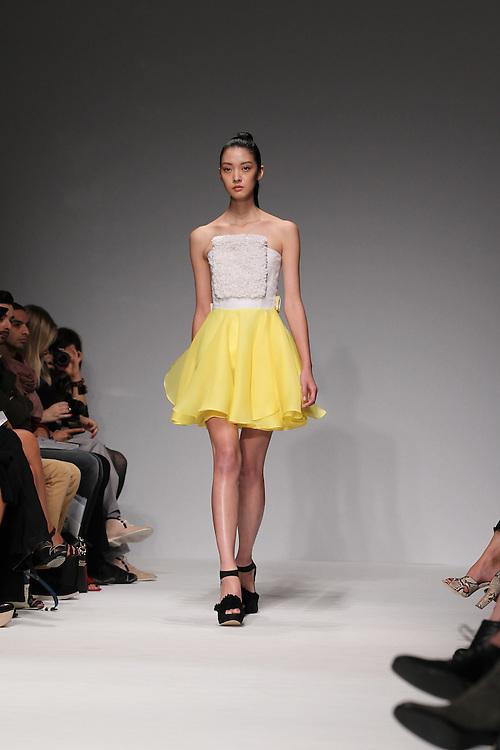 Models walk the catwalk for the Emilio de la Morena Show during the spring 2012 London Fashion Week shows.