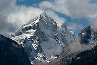 A late-summer storm breaks up Monday morning to reveal a fresh layer of snow on Buck Mountain and other high peaks in Grand Teton National Park.
