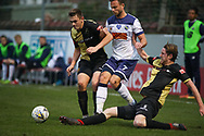 Marine defender Anthony Miley (5) makes a tackle during the The FA Cup match between Marine and Havant & Waterlooville FC at Marine Travel Arena, Great Crosby, United Kingdom on 29 November 2020.