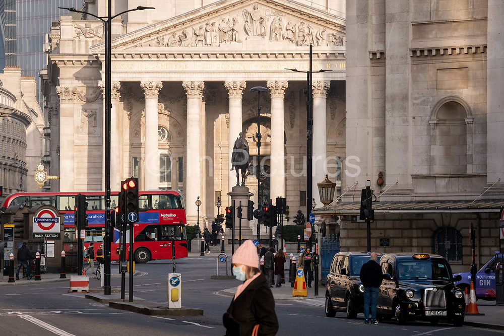 Days before the Chancellor Rishi Sunak delivers his Budget, little traffic or pedestrians pass through a quiet Queen Victoria Street during the third lockdown of the coronavirus pandemic, in the City of London, the capitals financial district, on 1st march 2021, in London, England.
