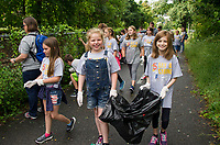 Picking up trash along the WOW Trail as part of the Day of Caring with the United Way.  (Karen Bobotas Photographer)
