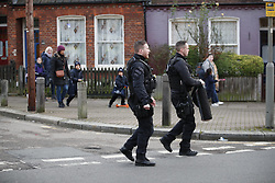 © Licensed to London News Pictures. 18/01/2019. London, UK. Children leave a nearby school as armed police arrive at a residential address in Balham, south London where police are negotiating with a man who is inside the house with a knife. Photo credit: Peter Macdiarmid/LNP